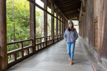 woman walking in japanese wooden house
