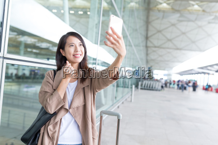 woman go travel and taking selfie