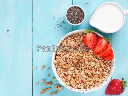 bowl with muesli fresh strowberry chia