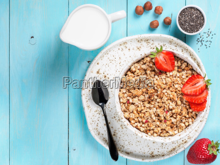 bowl with muesli fresh strowberry nuts