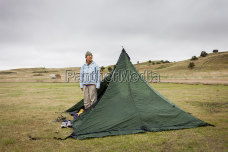 woman standing in tent
