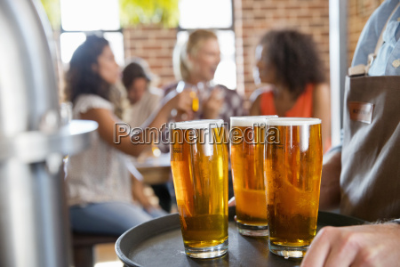 close up of pints of beer