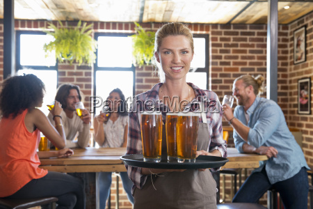 portrait of waitress by counter in