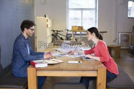 man and woman working on project
