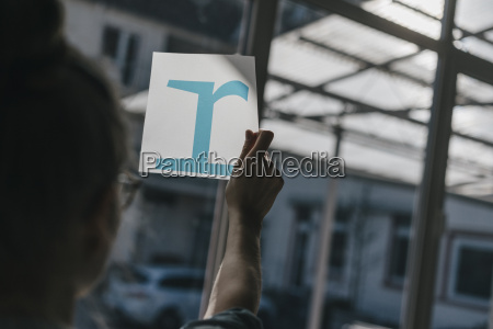 woman holding letter template