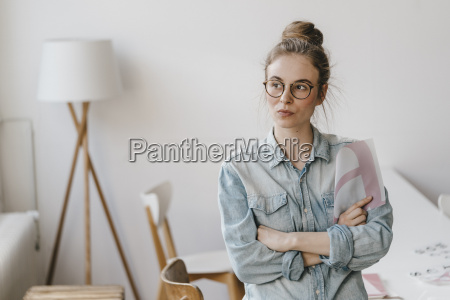 young woman holding letter template looking