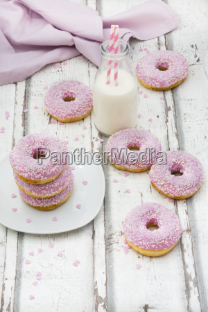 doughnuts with pink icing and sugar