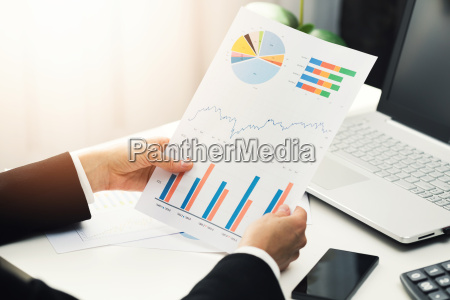 woman at office analyzing business financial