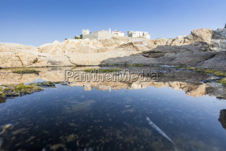 the ancient fortified citadel reflected in