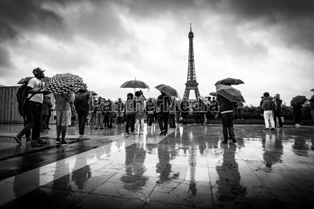reflections of tourists in the rain