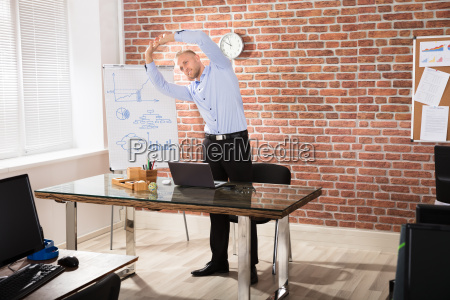 man exercising in office