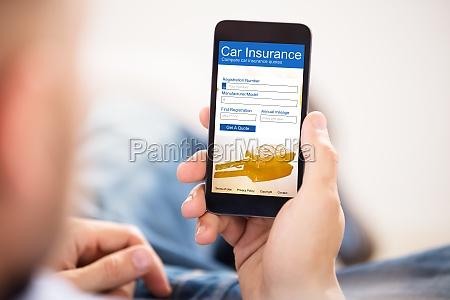 man filling car insurance form on