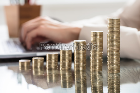 stack of increasing coins on office