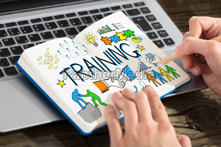 business person drawing training chart on