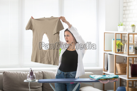 woman looking at burnt t shirt