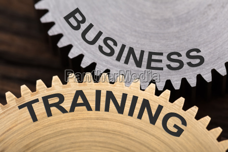 business training concept on interlocked cogwheels