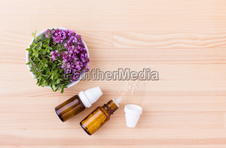 homeopathic remedy with flowering wild thyme