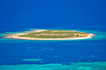 island in turquoise sea aerial view