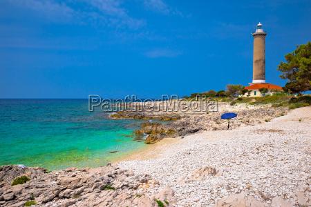 veli rat lighthouse and turquoise beach