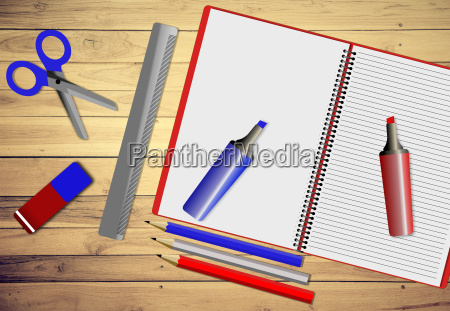 assortment of school supplies on wooden