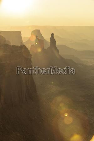 sun beam cutting through rock formations
