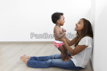 side view of woman sitting on