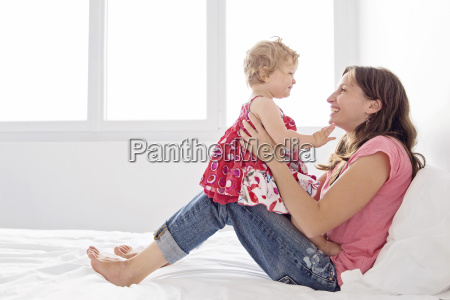 woman sitting on a bed young