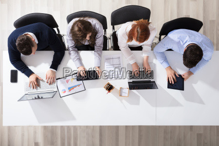 business people using electronic devices at