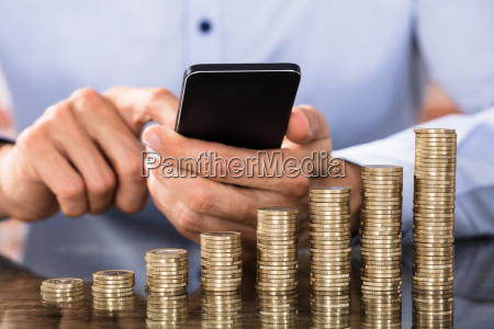businessman using smart phone for calculating