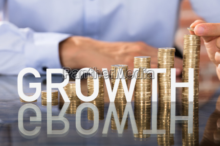 growth text in front of coins