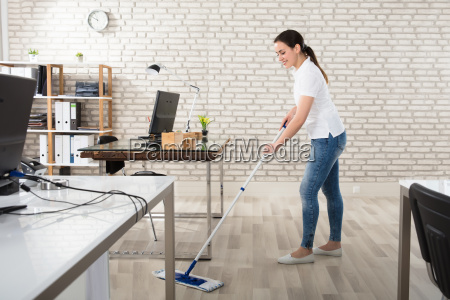young woman cleaning the floor