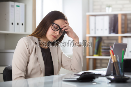 sad businesswoman in office
