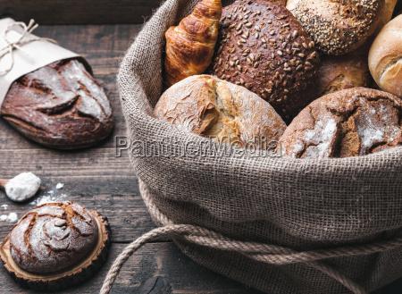 delicious fresh bread inside a sack