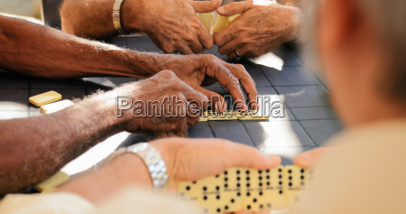 retired old men playing domino game