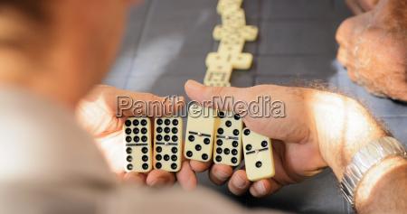 retired senior man playing domino game