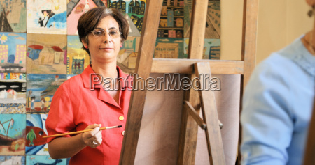 portrait of happy woman smiling painting