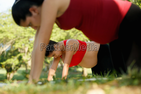 pregnant woman doing yoga workout for