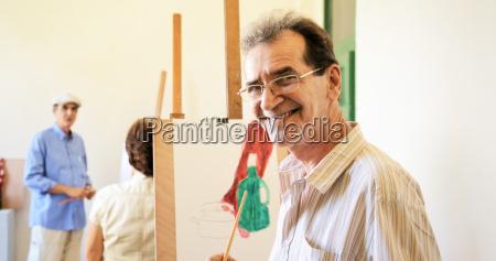 old man painting happy senior people