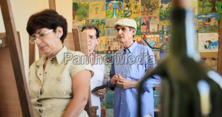 old man teaching art professor working