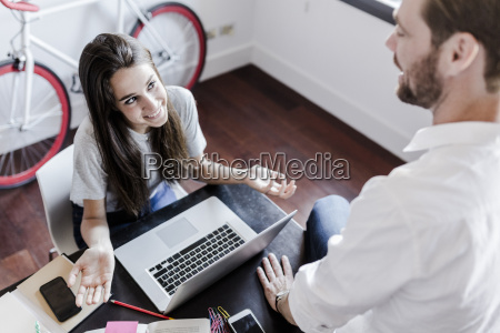 smiling couple with laptop and cell