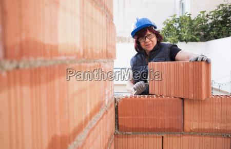 portrait of smiling senior woman building