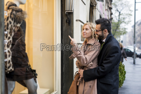 business couple window shopping in the