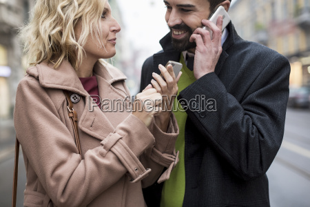 happy business couple with cell phones