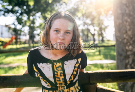 portrait of freckled girl outdoors