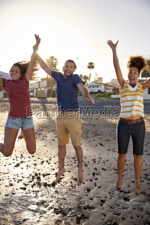 happy friends jumping in the air