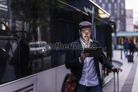 young man at the bus stop