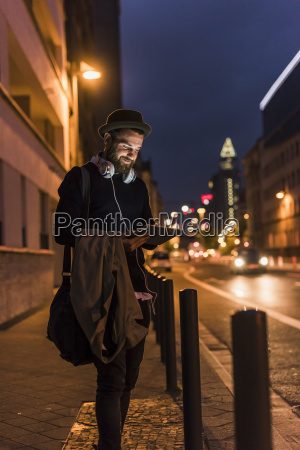 stylish young man with tablet on