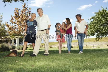 happy extended family in garden