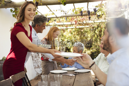 happy family setting table outside for