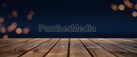 dark blue bokeh background with wooden